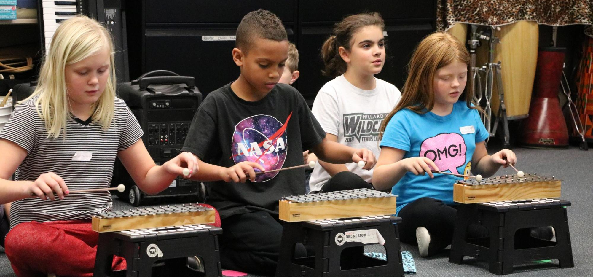 kids playing instruments in music class